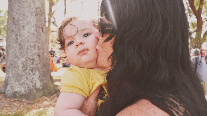grandma kissing baby