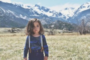 Cute fashion toddler in front of mountains
