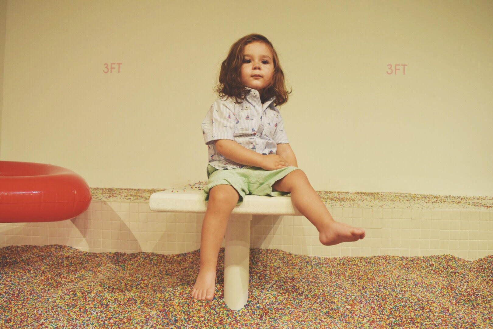 toddler at museum of ice cream sprinkle pool