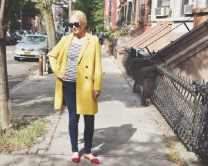 Chondra Sanchez in yellow Lafayette 148 coat on Brooklyn street