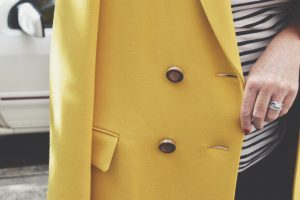 Close on button detail of Lafayette 148 coat