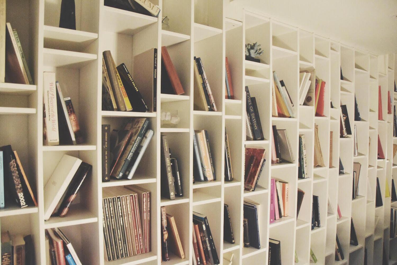 bookshelf at the postcard inn