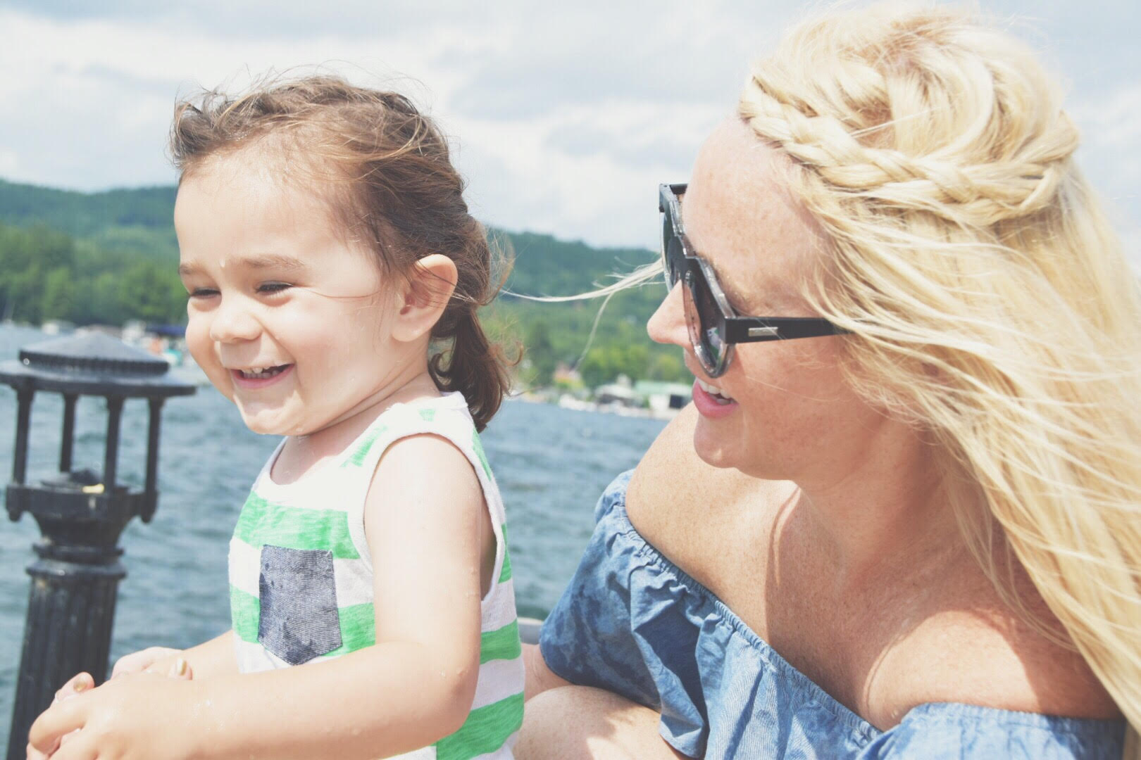 Mom and Child laughing on lake