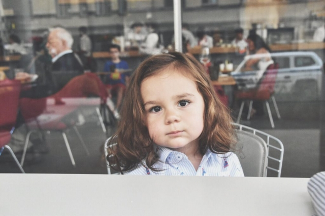 toddler sitting outside Untitled restaurant at the whitney museum niece