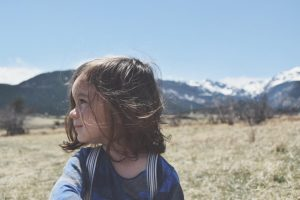 Cute toddler in front of mountains