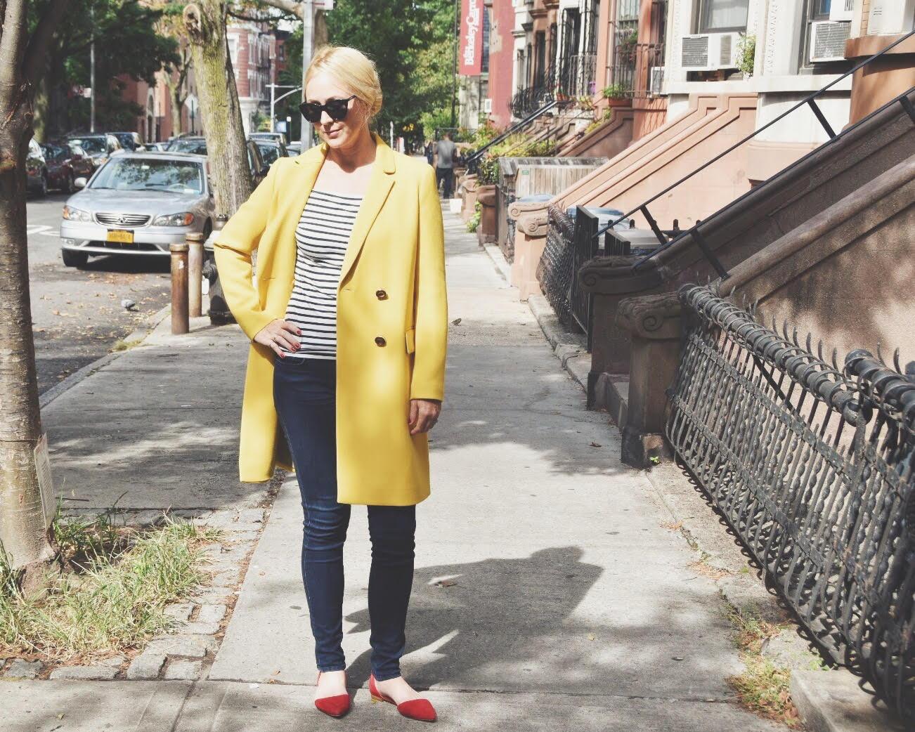 Chondra Sanchez in yellow Lafayette 148 coat on Brooklyn street
