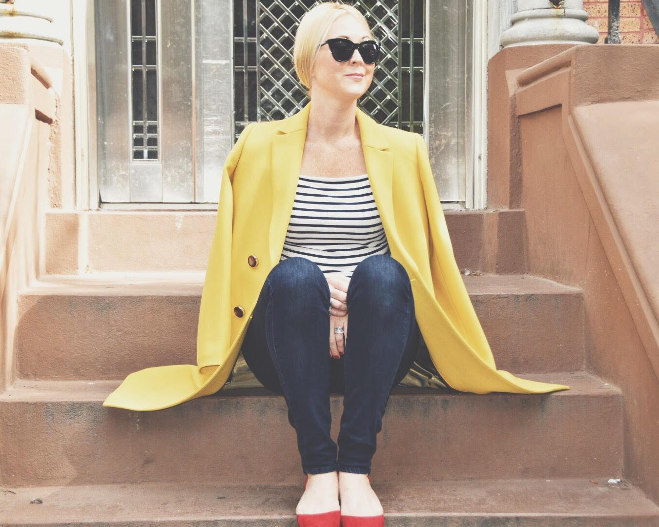 Chondra Sanchez in yellow Lafayette 148 coat on stoop
